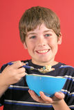 Young boy eating cereal vertic Stock Photography