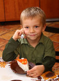Young Boy Eating Cheesecake Stock Photography