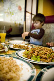 Young boy eating chinese food Stock Image
