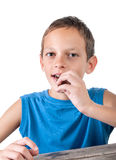 Young boy eating chocolate Stock Photos