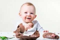 A boy eating chocolate. A young boy eating a chocolate Easter egg Stock Photos