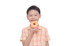 Young boy eating donut over white Stock Images