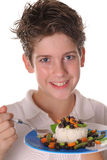 Young boy eating healthy rice, beans & veggies ver Royalty Free Stock Images