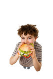 Young boy eating healthy sandwich Stock Photos