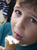 Young boy eating ice cream Stock Images