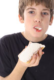 Young boy eating a pastry Stock Photo