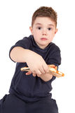A young boy eating pizza Stock Photography