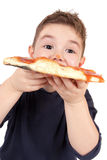A young boy eating pizza Royalty Free Stock Photography