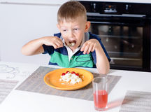 Young Boy Eating Plate of Cheese and Fruit Royalty Free Stock Photography