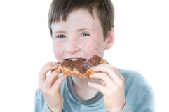 Young boy eating slice of bread Stock Photography