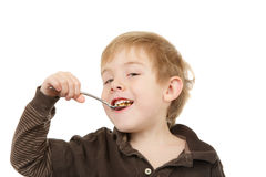 Young  boy eating a spoonful of cereal Stock Image