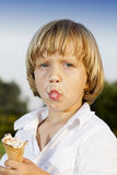 Young boy eating a tasty ice cream Royalty Free Stock Photography
