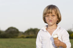 Young boy eating a tasty ice cream Royalty Free Stock Image
