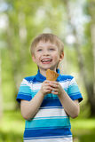 Young boy eating a tasty ice cream outdoor Stock Photos