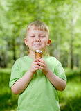 Young boy eating a tasty ice cream outdoor Royalty Free Stock Photography