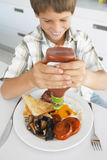 Young Boy Eating Unhealthy Fried Breakfast Royalty Free Stock Images