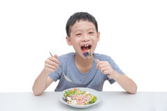 Young boy eating vegetables Royalty Free Stock Image