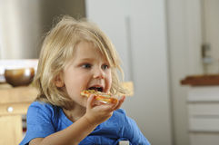 Young boy eats pizza Stock Photo