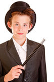 Young Boy in Elegant Magician Attire Against White Stock Photography