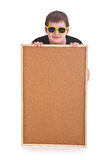 Young boy and empty bulletin board Royalty Free Stock Photos