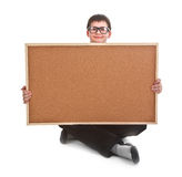 Young boy and empty bulletin board Royalty Free Stock Photo