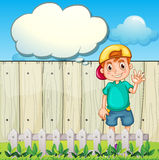 A young boy with an empty thought standing near the fence Royalty Free Stock Photos