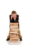 Young boy with encyclopedia. Young boy, prodigy next to encyclopedia books. white background royalty free stock images