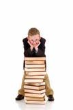 Young boy with encyclopedia. Young boy, prodigy next to encyclopedia books. white background stock photos