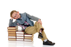 Young boy with encyclopedia. Young boy, prodigy next to encyclopedia books. white background royalty free stock photos