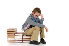 Young boy with encyclopedia. Young boy, prodigy next to encyclopedia books. white background stock photo