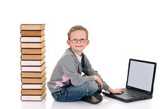 Young boy with encyclopedia Stock Photography