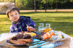 Young boy enjoying breakfast Royalty Free Stock Photo
