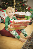 Young Boy Enjoying Christmas Morning Near The Tree Stock Photo