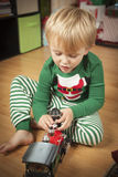 Young Boy Enjoying Christmas Morning Near The Tree Royalty Free Stock Image