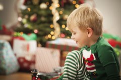 Young Boy Enjoying Christmas Morning Near The Tree Stock Photos