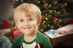 Young Boy Enjoying Christmas Morning Near The Tree Stock Image