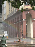 Young Boy Enjoying Downpour, Havana, Cuba Royalty Free Stock Photos