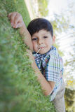 Young Boy Enjoying His Lollipop Outdoors Laying on Grass Stock Images