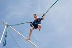 Young boy  enjoying jumping with trampoline jumping rope Royalty Free Stock Images