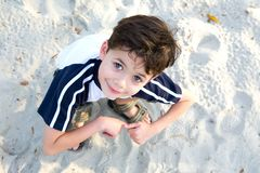Young boy enjoying the sandpit Stock Photo
