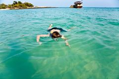 Young boy enjoying snorkeling in the sea Royalty Free Stock Image