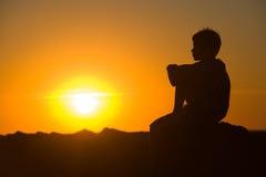 Young boy enjoying sunset royalty free stock image