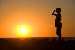 Young boy enjoying sunset Stock Photos