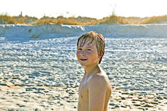 Young boy enjoys the beach Royalty Free Stock Photo