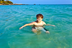 Young boy enjoys the clear water Stock Photo