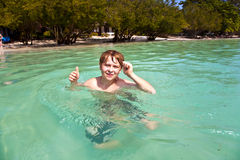 Young boy enjoys swimming Royalty Free Stock Photo