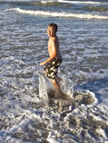 Young boy enjoys the waves Stock Photo