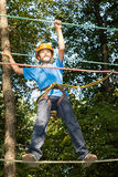 Boy with equipment climber moves on ropes Stock Photography