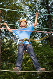 Boy with equipment climber moves on ropes. Stock Photos