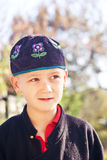 Young boy in ethnic cap Stock Photos